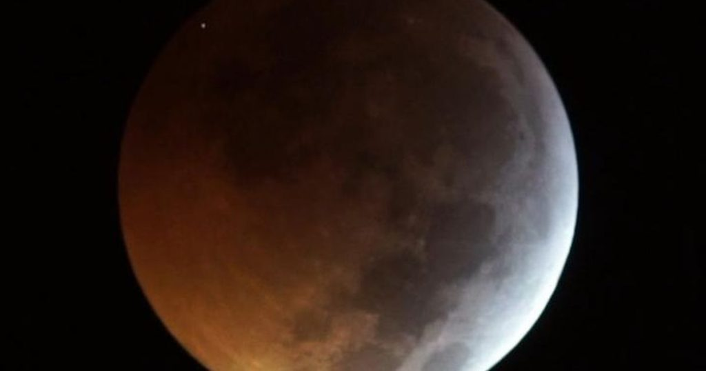 A Fast-Moving Meteorite Slammed into the Moon during Total Eclipse